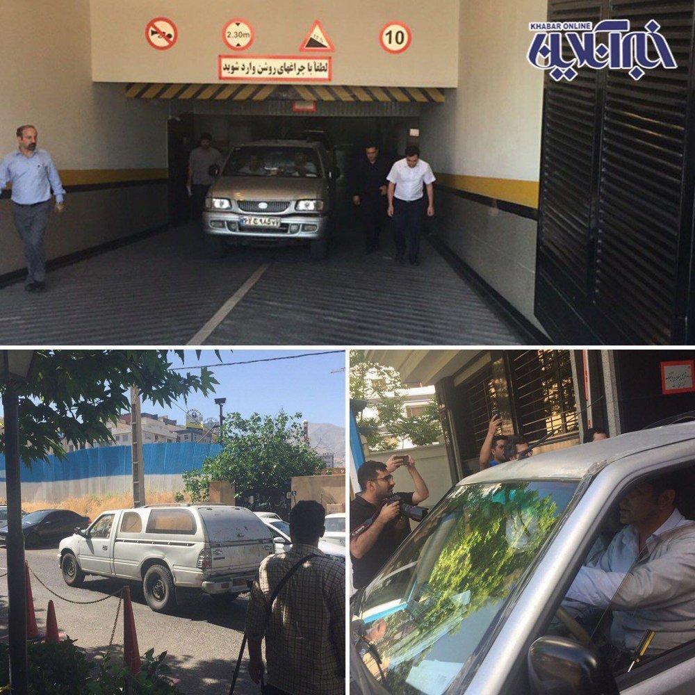 آمبولانس حامل جسد میترا استاد در حال خروج از ساختمان محل سکونت او/ عکس